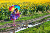 Girl trying to walk over mud puddle — Stock Photo