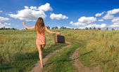 Girl walking in the countryside — Stock Photo