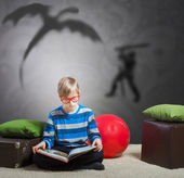 Preteen boy reading a book — Stock Photo