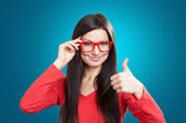 Girl with a thumb up — Stock Photo