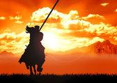 Horse riding warrior — Stock Photo
