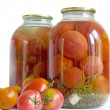 Pickled tomatoes in glass jars — Stock Photo #12087380