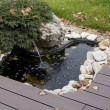 Small artificial pond at site — Stock Photo #13879959