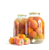 Preserved red tomatoes in a glass jar — Stock Photo