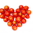 Fresh tomatoes stacked in the form of heart — Stock Photo