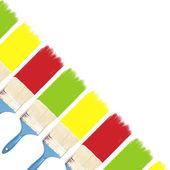 Pensel och färg ligger på en diagonal — Stockfoto