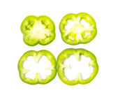 Slices of green peppers on white background — Stock Photo