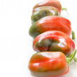 Red and green bell peppers — Stock Photo