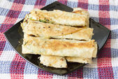 Pita bread stuffed with herbs and cheese — Stock Photo