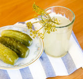 Pickles and pickle in a glass — Stock Photo
