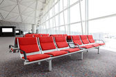 Row of red chair at airport — Stock Photo