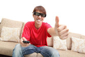 Man wearing 3d glasses watch tv and thumb up — Stock Photo