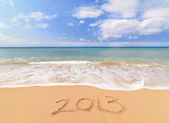 Happy new year for 2013 on the sand — Stock Photo