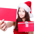 Christmas girl showing red xmas card — Stock Photo