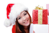 Christmas happy girl smile holding gift — Stock Photo