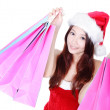 Woman hold shopping bag with christmas hat — Stockfoto