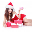 Happy Christmas woman Lying and holding gift — Stock Photo