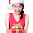Christmas Girl happy holding gift — Stock Photo #14037223