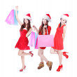 Three christmas girls excited shopping — Stock Photo
