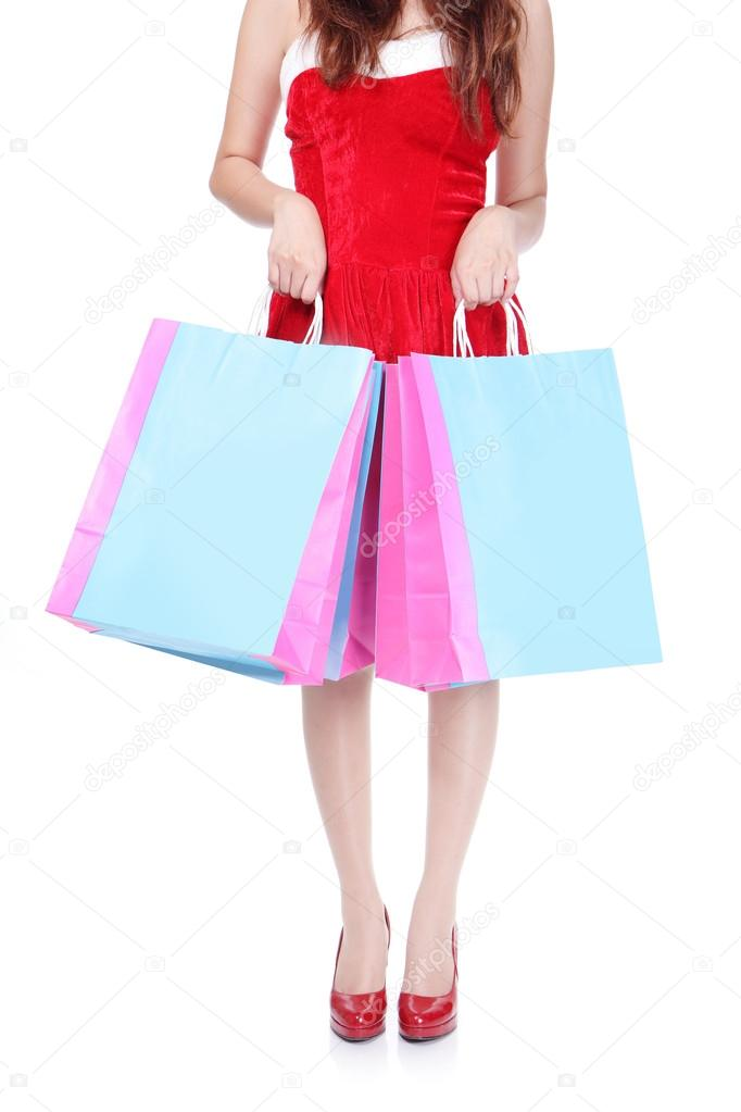 Close up of red shopping woman leg and bag isolated on white background — Stock Photo #14952373