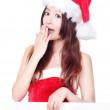 Royalty-Free Stock Photo: Excited Christmas girl holding blank billboard