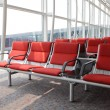 Red chair at airport - Stock Photo