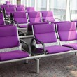 Royalty-Free Stock Photo: Row of purple chair at airport