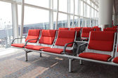 Red chair at airport — Stock Photo