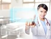 Doctor woman touch empty button — Stock Photo