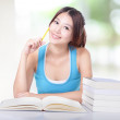 Girl study book and smile to you — Stock Photo