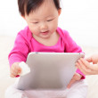 Girl baby happy play tablet PC — Stock Photo #16811373