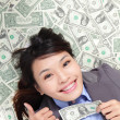 Business woman show thumb up with money — Stock Photo #16980523