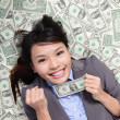 Business woman hold fist with money — Stock Photo