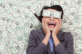 Business woman excited lying on money — Stock Photo