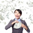 Business woman with earned money — Stock Photo