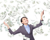 Business woman look up under money rain — Stock Photo