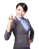 Business woman writing in the air — Stock Photo