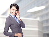 Business woman speaking mobile phone — Stock Photo
