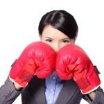 Постер, плакат: Business woman with boxing gloves