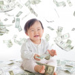 Baby excited smile with money rain — Stock Photo