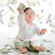 Baby catch money rain in the air — Stock Photo