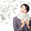 Woman smile happy with handful of money - Stock Photo