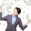 Business woman happy under money rain — Stock Photo #18506259