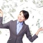 Business woman happy under money rain — Stock Photo