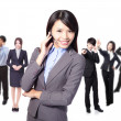 smiling call center executive with colleagues — Stock Photo #18506339