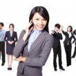 Smiling call center executive with colleagues - Stock Photo
