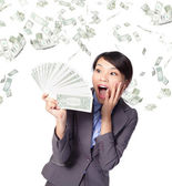 Business woman look handful of money — Stock Photo