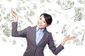 Business woman happy under money rain — Stock Photo