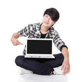 Young man finger point to empty computer screen — Stock Photo