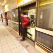 Moving leaving train at metro station — Stock Photo